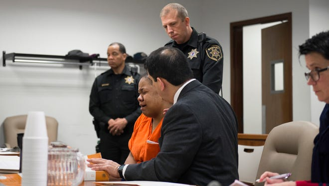 Public defender Ed Rivas consoles Nadajia Hill as she is ordered to remain in jail at a March 15 detention hearing in Superior Court, Camden.