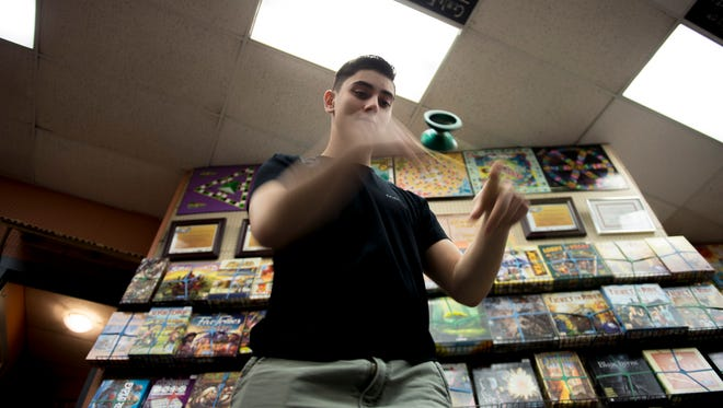 Mike Scimeca, 18, yo-yos inside Tiki Tiki Board Games Tuesday, March 27, 2018 in Woodbury, N.J.