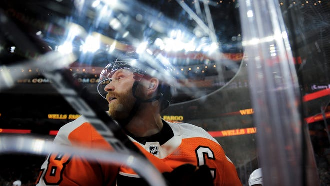 Flyers' Claude Giroux (28) comes off the boards during a game against the Hurricanes Thursday, April 5, 2018 at the Wells Fargo Center in Philadelphia, Pa. The Flyers won 4-3.