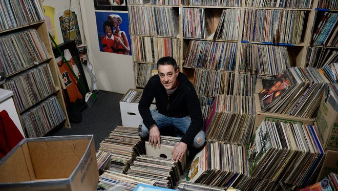 Owner Dave Frankel surrounded by records in the backroom of Inner Groove Records apple Tuesday, April 10, 2018 in Collingswood, N.J.