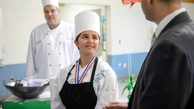Ella Bruno Sileo is awarded first place for her 'Thai taco wraps' in a Future Chef competition at Wallace Intermediate School Thursday, April 12, 2018 in Vineland, N.J.