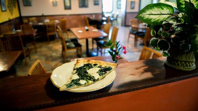 A slice of pizza inside Villa Rosa Restaurant & Pizzeria in Burlington, N.J.