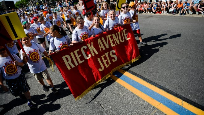 Students from Rieck Avenue Elementary School parade on North High Street for the school district's 41st annual Olympic Day on Friday, May 25, 2018 in Millville, N.J.