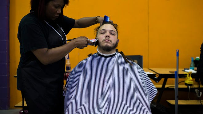 A.R. Rodriguez receives a free haircut during a Father Appreciation event hosted by Prevent Child Abuse New Jersey Thursday, June 7, 2018 in Mount Laurel, N.J.