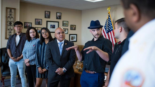 Rutgers graduate Matteo Resanovic, alongside Camden Mayor Frank Moran, reflects on the night he and fellow classmates rescued a man in a house fire back in March 2018. They are seen here Tuesday, June 12, 2018 at the mayor's office during a recognition ceremony for their efforts.