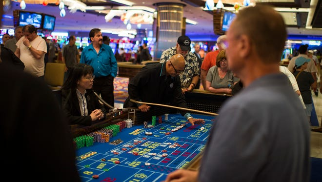 The craps table bustles inside the Hard Rock Hotel & Casino Thursday, June 28, 2018 in Atlantic City. N.J.