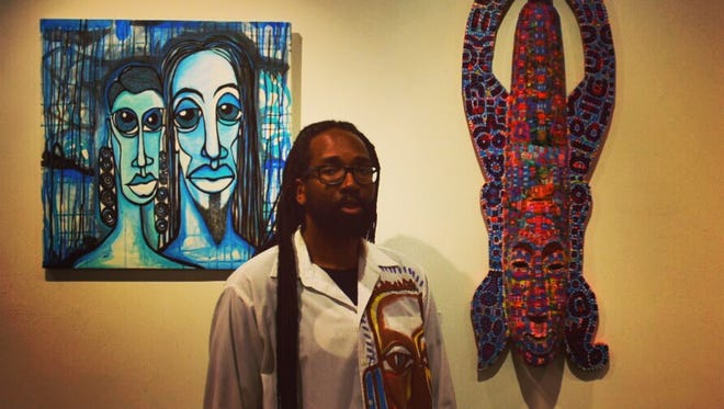 """Kortez, pictured with two of his works from """"Life Is Nothing Without Hue."""""""