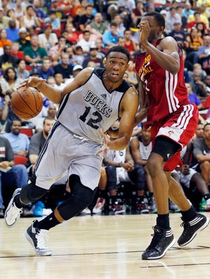 Jabari Parker of the Milwaukee Bucks drives by Andrew Wiggins of the Cleveland Cavaliers in an NBA Summer League basketball game on Friday in Las Vegas, Nev.