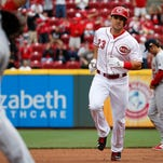 Cincinnati Reds' Adam Duvall rounds the bases after hitting the game winning two-run home run in the eighth inning of a resumed baseball game against the St. Louis Cardinals, Saturday, Sept. 12, 2015, in Cincinnati. The game was resumed in the top of the eighth inning after it was suspended Sept. 11 due to rain. The Reds won 4-2.