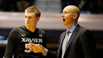 Xavier head coach Chris Mack and guard J.P. Macura in the final minutes of the game.