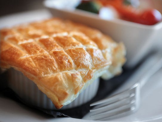Highlander Scottish Pub chef Martin Mitchell's steak pie comes with a flaky crust and fresh vegetables at the pub in Collierville's town square.