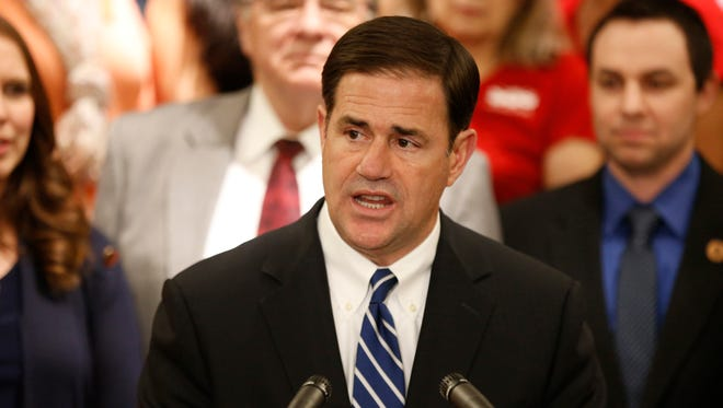 Gov. Doug Ducey announces his plan to raise teachers pay by 20 percent over the next two years at the State Capitol in Phoenix, on April 12, 2018.