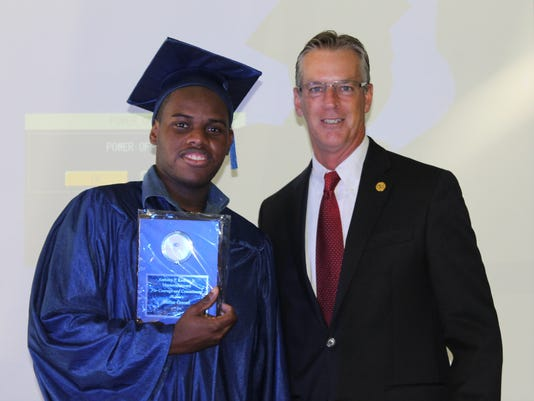 Kemar Greene and John King at graduation.jpg