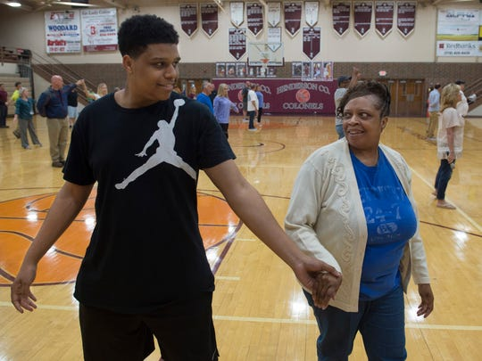 """DeJohn Eldridge and his mom, Avonda Vincent, give the waltz a whirl in the gymnasium of Henderson County High School Monday evening. The 2017 prom is Saturday evening at County High. The theme is """"Rustic Romance."""""""