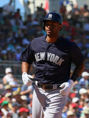 Aaron Hicks hits a home run in the third inning.