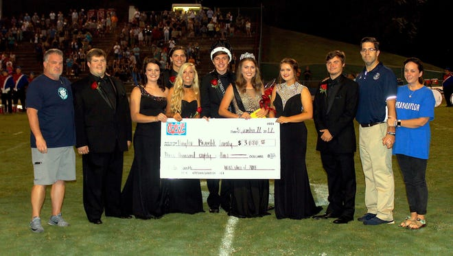 Warren County presented a check for more than $3,000 to Baylor Bramble's family during Friday's game with Siegel.