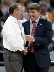 North Carolina State coach Wes Moore, right, congratulates