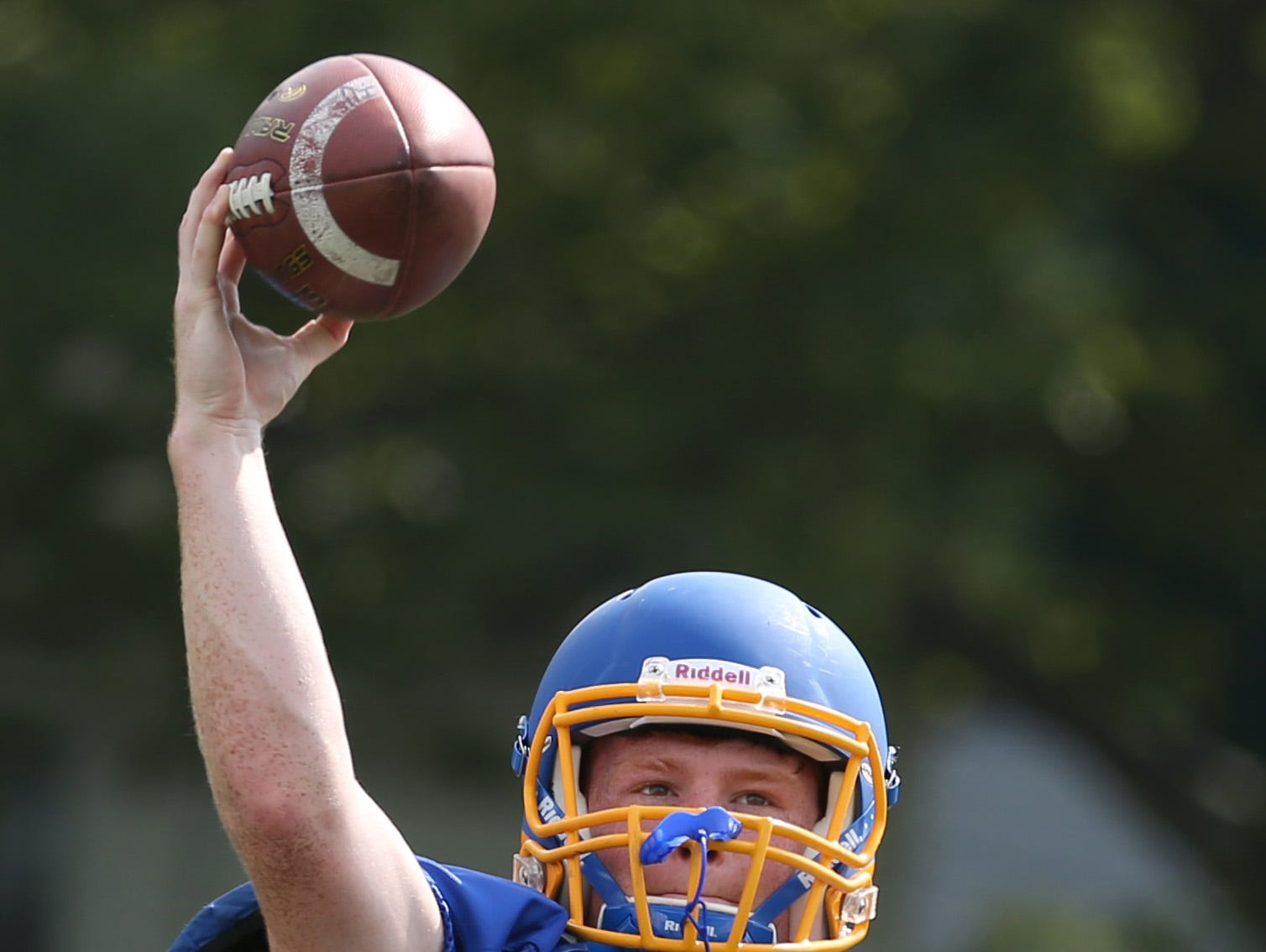 Irondequoit senior quarterback Sean Mannion throws long.