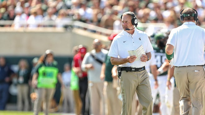 Sep 2, 2017; East Lansing, MI, USA; Michigan State head coach Mark Dantonio watches the season opener against Bowling Green in the first quarter at Spartan Stadium.