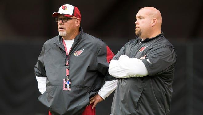 Cardinals head coach Bruce Arians (left) and GM Steve Keim watch training camp at University of Phoenix Stadium July 29, 2014.