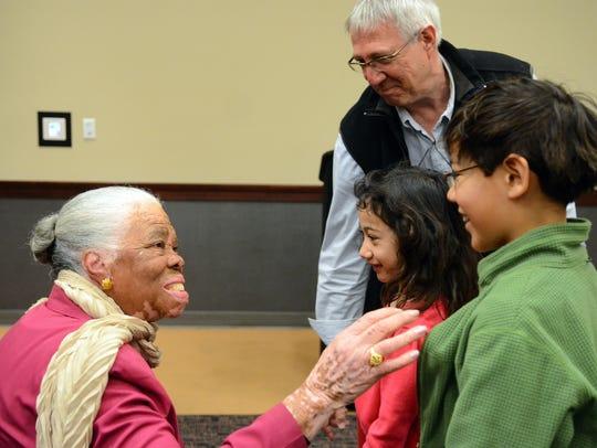 Civil rights activist Peggy Jean Connor, left, talks