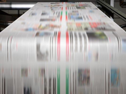 Offset printing press at work