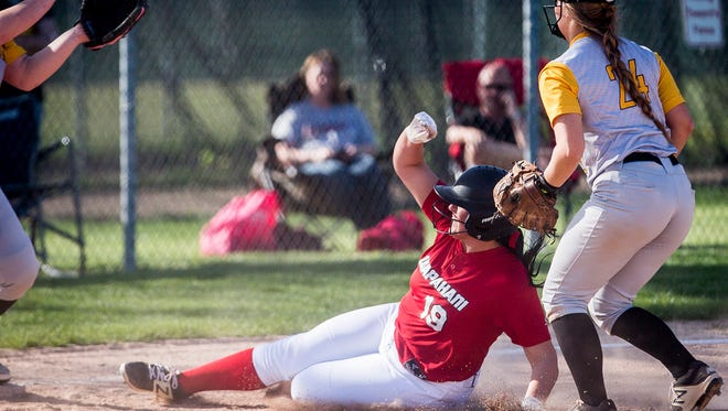 Wapahani's Dayten Lee slides into third base against Cowan during the Delaware County Softball Tournament at Wes-Del High School Tuesday, May 1, 2018.