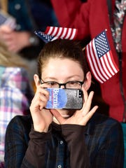Anjulia Willmer of Los Angeles takes a picture at a rally for Democratic presidential candidate Sen. Bernie Sanders, I-Vt.,  on primary election night in Concord, N.H., on Tuesday, Feb. 9, 2016.