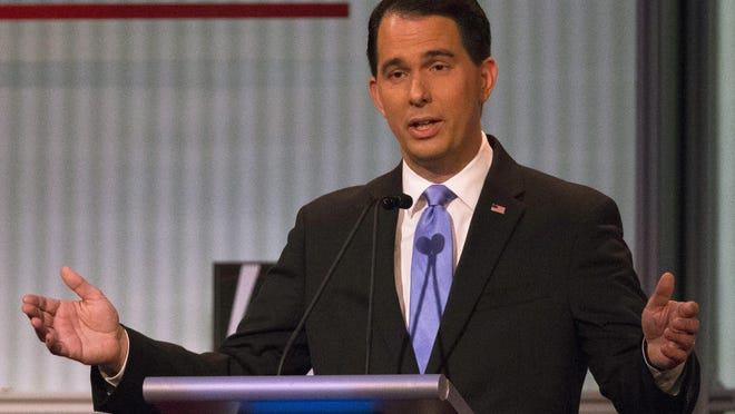 Republican presidential candidate and Gov. Scott Walker speaks during the first Republican presidential debate at the Quicken Loans Arena on Thursday in Cleveland.