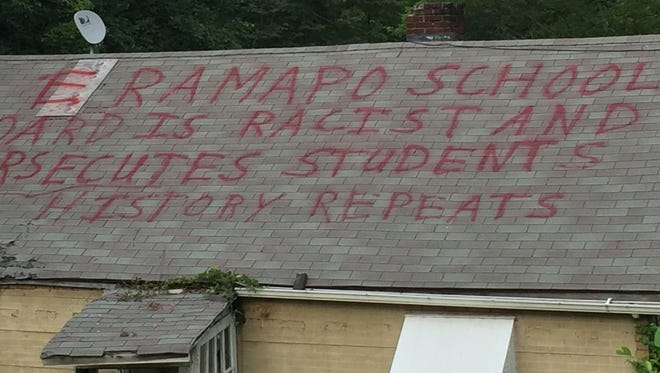 Message critical of the East Ramapo Board of Education painted on roof of abandoned building off Conklin Road in Pomona, as seen Aug. 24, 2015.
