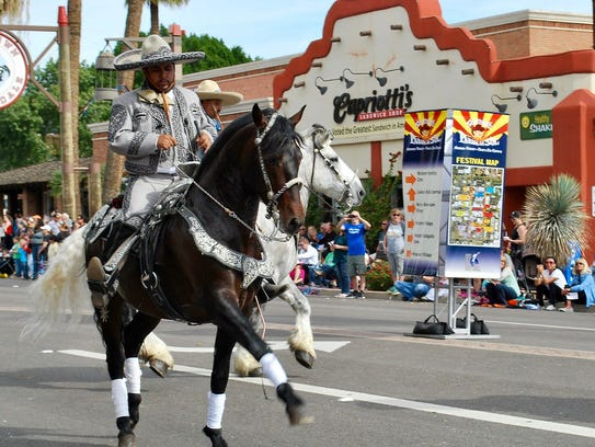 A number of horseback riders take part in the Parada