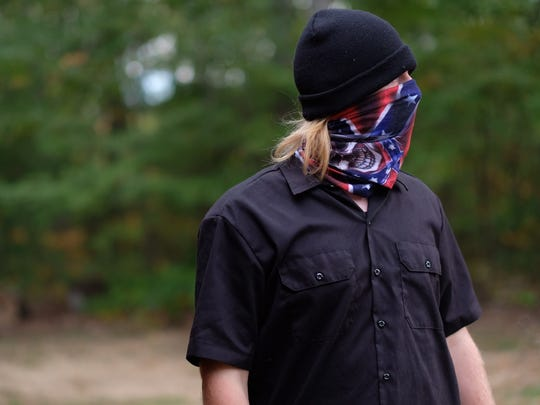 A white supremacist with the Stormfront group attends a Stormfront summit in Crossville on Saturday, Sept. 30, 2017.
