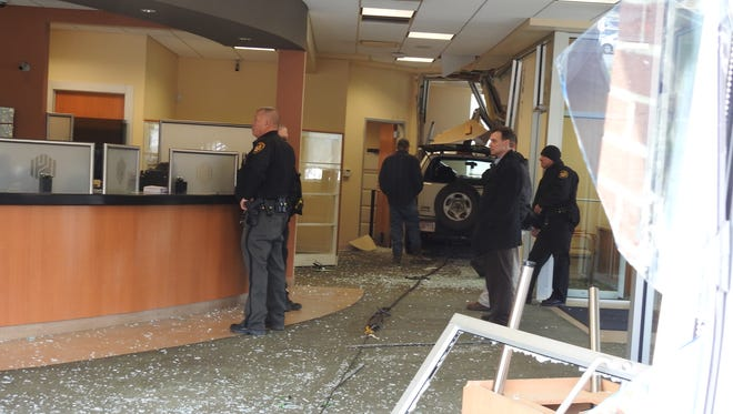 Five people were transported with minor injuries after a jeep crashed into the Huntington Bank on Maysville Pike.