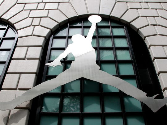In this June 27, 2011 file photo, the Nike Air Jordan logo is shown in front of the Niketown store in downtown Portland, Ore.