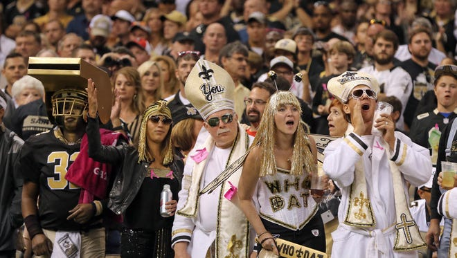 Saints fans cheer for their team at the Mercedes-Benz Superdome on Oct. 5.