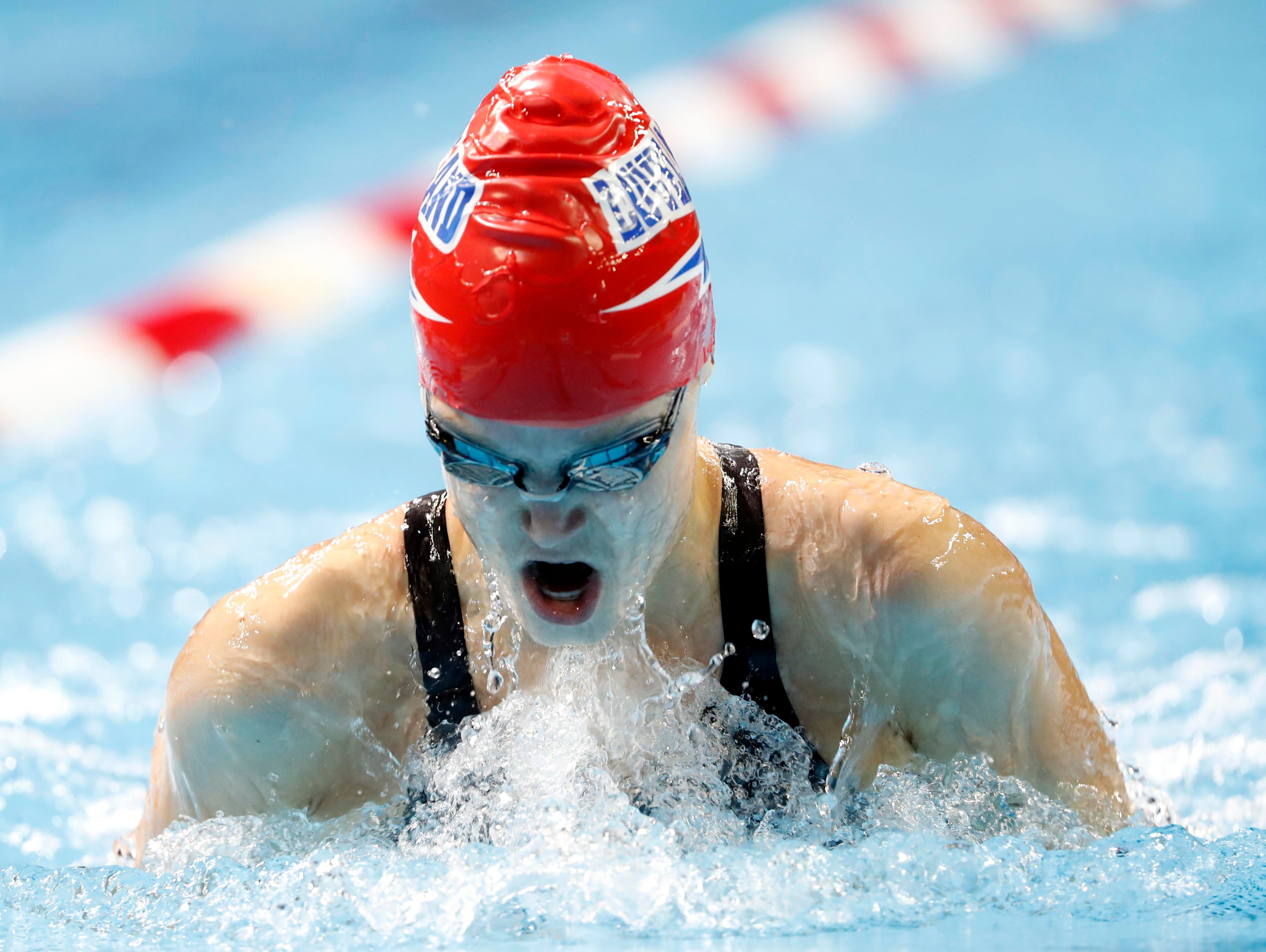 Windsor's Morgan Friesen swims during the women's 100 breaststroke preliminary heats in the U.S. Olympic swimming team trials at CenturyLink Center on Monday.