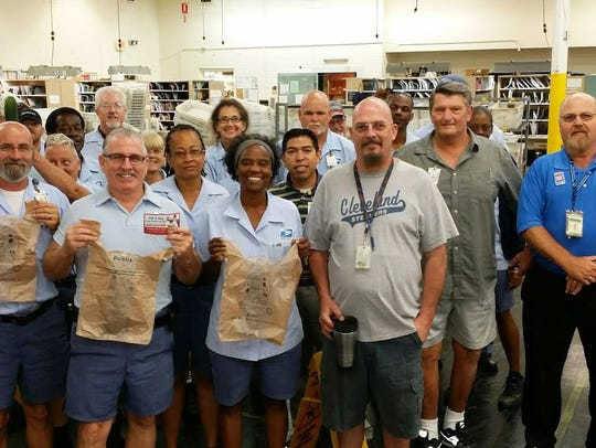 Letter carriers from the Orange Avenue post office in Fort Pierce prepare for the annual Stamp Out Hunger Food Drive in 2015.