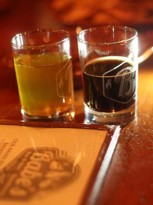 """Two samples from the brewery as """"Lift Your Spirits"""" visits Babe's Bar-B-Que and Brewhouse at The River in Rancho Mirage, October 2014."""