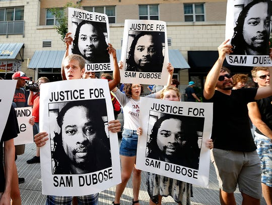 "Demonstrators chant ""No justice, no peace"" during a"