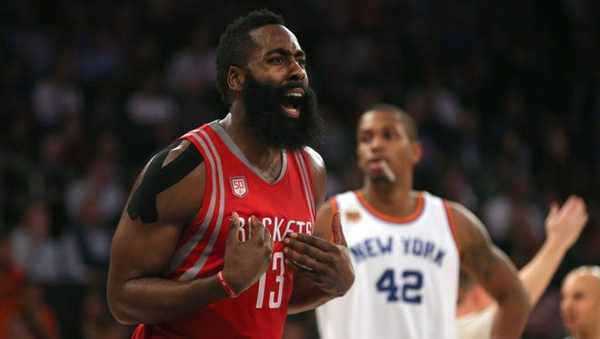 Houston Rockets shooting guard James Harden (13) reacts during the third quarter of Wednesday's game against the New York Knicks at Madison Square Garden.