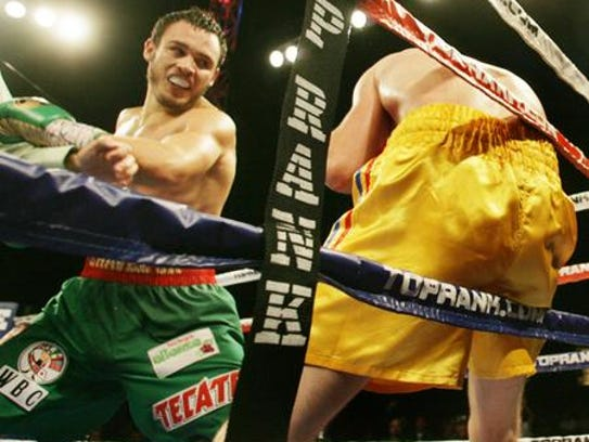 Julio Cesar Chavez, Jr. swung at Andy Lee who was on