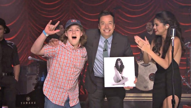 Franklin High School senior Andrew Kochamba, left, with host Jimmy Fallon and Selena Gomez on 'The Tonight Show,' Wednesday, October 14, 2015