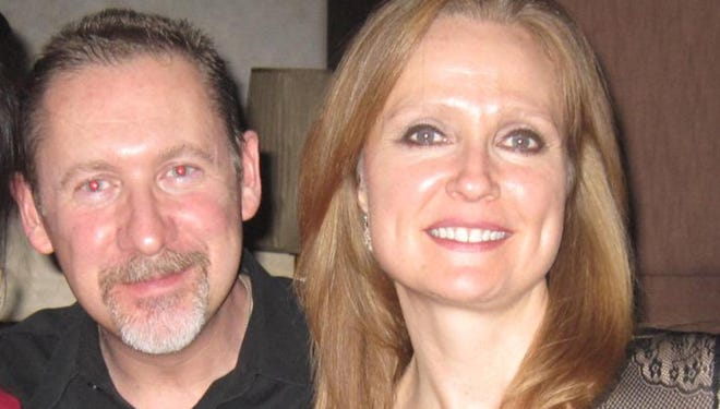 Sarah Bajc, shown with longtime partner Philip Wood in January 2012, remains skeptical of Malaysia's claims about the plane and maintains hope for their reunion.