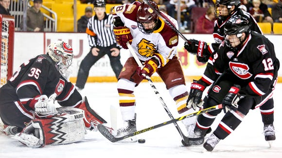 Kyle Osterberg (8) of Minnesota Duluth shoots the puck