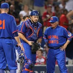 New York Mets catcher Travis d'Arnaud talks to manager Terry Collins after being injured against the Atlanta Braves in the sixth inning at Turner Field on June 20, 2015.