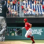 Washington Nationals catcher Wilson Ramos (40) rounds the bases after hitting a home run against Milwaukee Brewers starting pitcher Matt Garza (22) in the fifth inning at Nationals Park.
