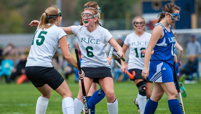 Rice's Clare Sheahan, center, celebrates her goal against Colchester in Essex Junction on Tuesday, October 20, 2015.