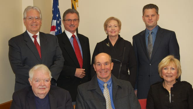 The Ocean Pines Association directors are seated from left, Dave Stevens, vice president; Tom Herrick, president; and Pat Supik, treasurer. Standing from left are: Doug Parks,  Slobodan Trendic, secretary; Cheryl Jacobs,and Brett Hill. This year's election will replace Stevens and Parks whose terms are expiring.