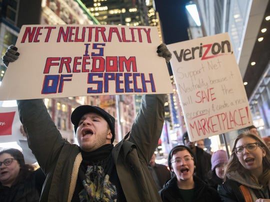 Demonstrators rally in support of net neutrality outside a Verizon store in New York in December 2017.