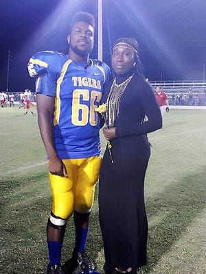 Expavious Tyrell Taylor, 20, with his sister Amanda Andrews, 25, in Clewiston, Florida. Taylor was killed in a shooting Saturday during ZombiCon in downtown Fort Myers, Florida. The siblings' mother died of meningitis in 2006 and father of epilepsy in 2013.